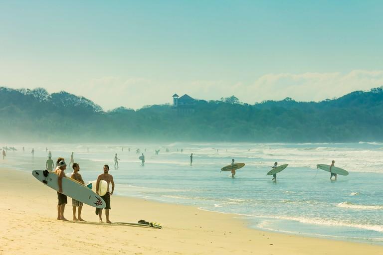 Surfers on Playa Guiones beach, Nosara, Nicoya Peninsula, Guanacaste Province, Costa Rica, Central America