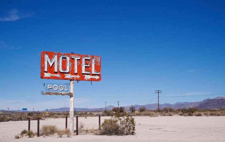 Old motel sign in the middle of the desert Yucca, Arizona