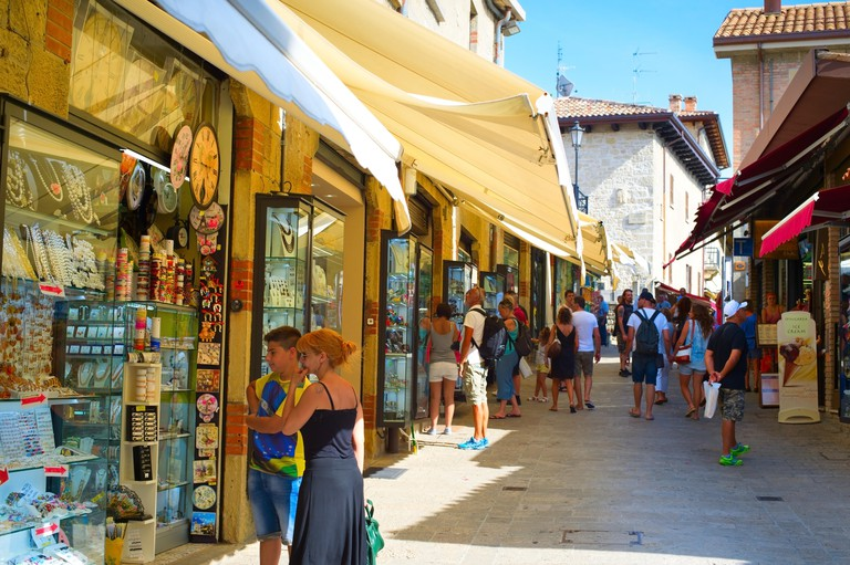 Tourists at the street of Old Town of San Marino. Tourism in San Marino contributes approximately