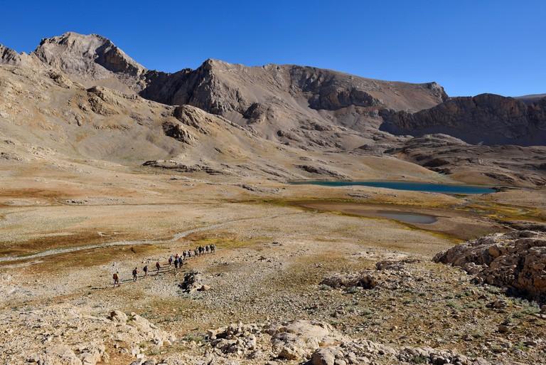 Group of hikers at Hastakoca Lake, Yedigoller Plateau, Aladaglar National Park, High or Anti-Taurus Mountains, Turkey