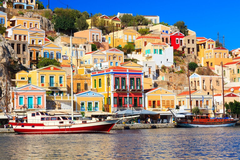 Boats in harbour at Symi Island in the Dodecanese Greece Europe