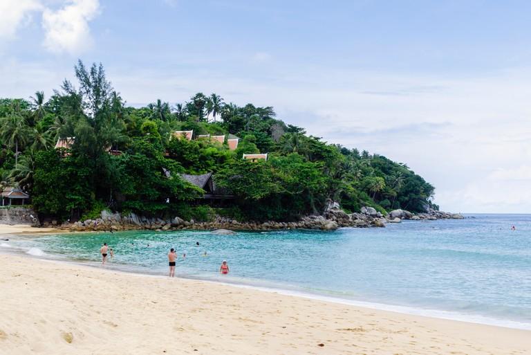 Holidaymakers on Karon Beach, Phuket, Thailand. Image shot 2014. Exact date unknown.