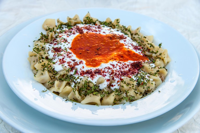 Traditional manti dumplings or Turkish ravioli served in a restaurant, Goreme, Cappadocia, Turkey