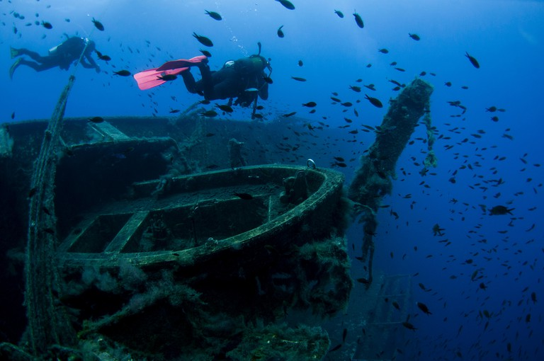 Diver at the MS Zenobia shipwreck. MS Zenobia was a Swedish built Challenger-class RO-RO ferry launched in 1979 that capsized an