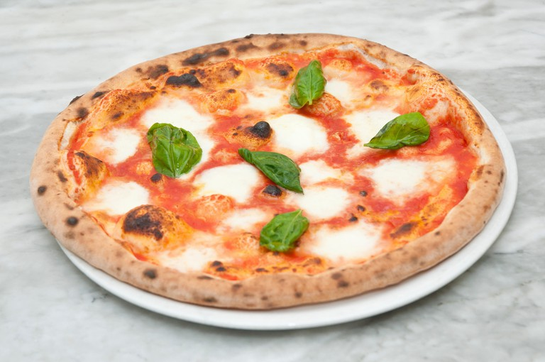 Pizza Margherita is the most famous all over the world. Typical italian dish with tomato, mozzarella, oil and basil.