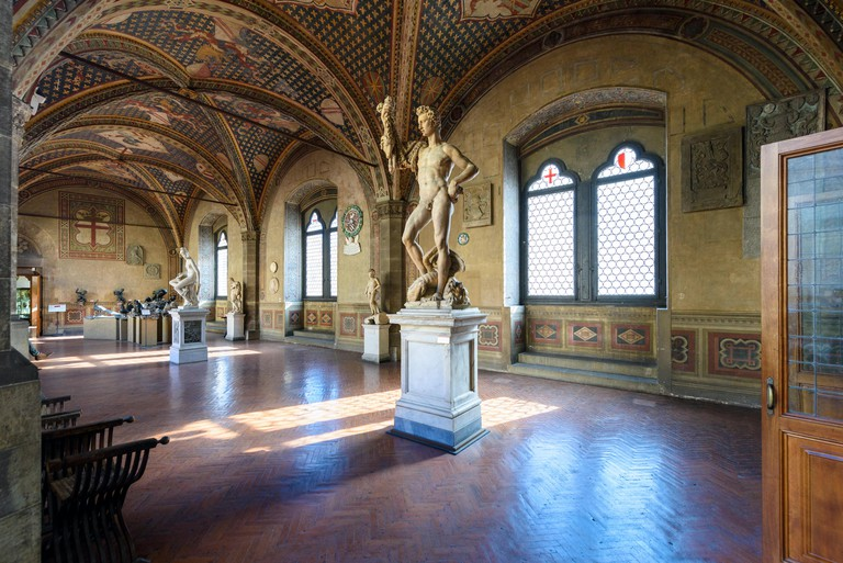 Florence. Italy. The Loggia, Museo Nazionale del Bargello. Sculpture of Jason (1589), by Pietro Francavilla, foreground.