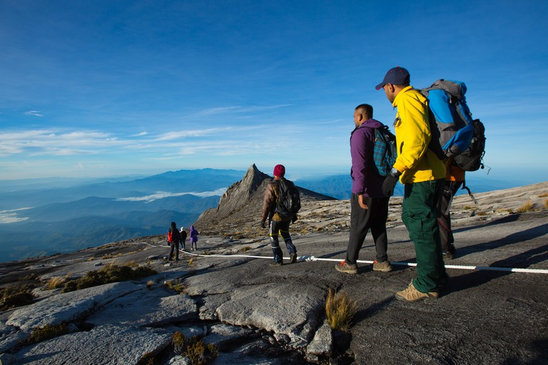 G1E0XW Ranau,Sabah,Malaysia-Undentified group of climber move down from the peak of Mount Kinabalu