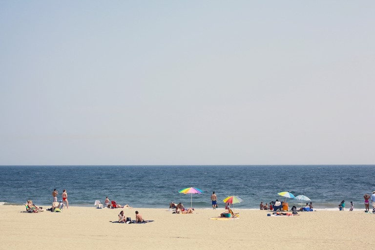 Diverse group of people enjoy day at the beach
