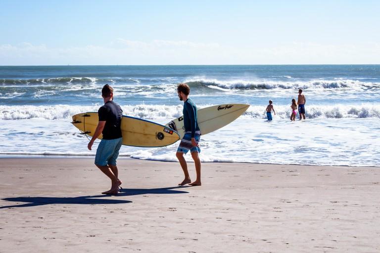 Surfers on Cocoa Beach, Florida, USA