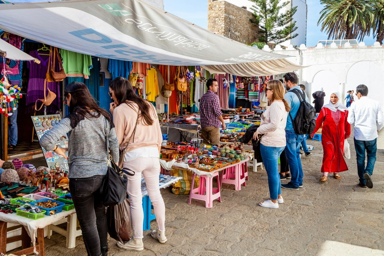 Tourists Shopping For Souvenirs In The Medina, Asilah, Morocco
