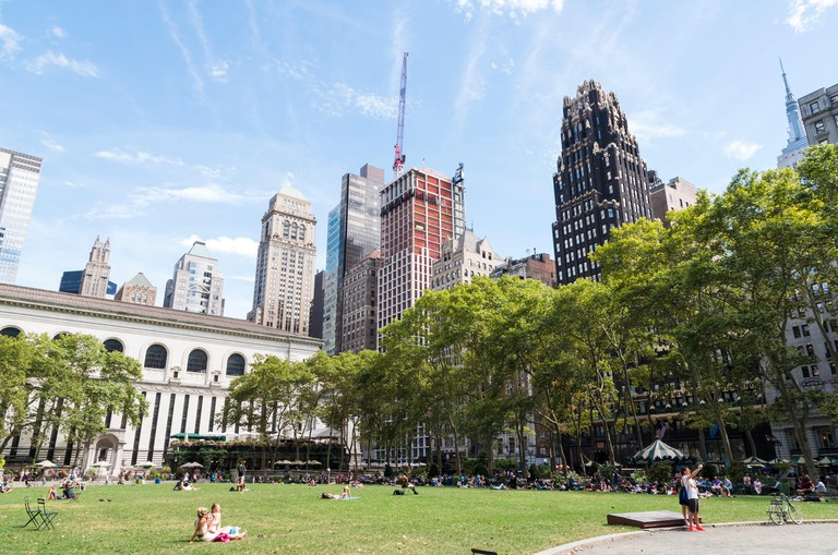 View across the Great Lawn in Bryant Park, New York, in Summer with the Bryant Park Hotel in the background