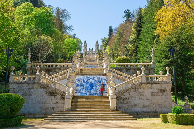 Lamego Portugal stairs, a woman climbs the 686 steps of the Baroque stairway leading to the church of Nossa Senhora dos Remedios in Lamego, Portugal