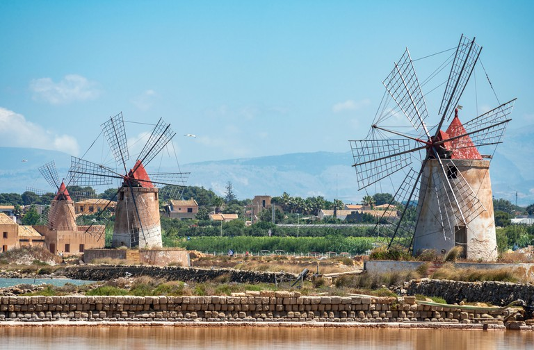 Saltpans and windmills in the Stagnone lagoon between Marsala and Trapani, on the west coast of Sicily, Italy.