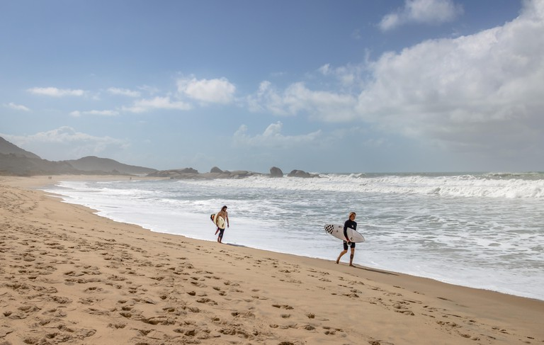 Surfers at Praia Mole (Mole Beach) - Florianopolis, Santa Catarina, Brazil