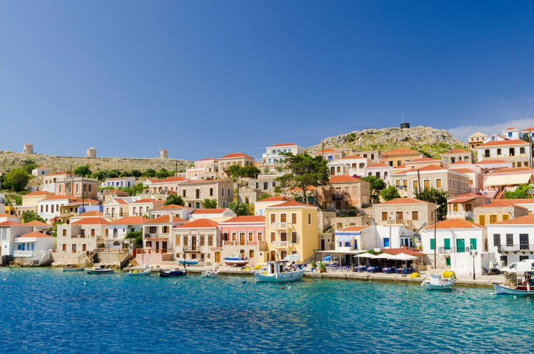 Pretty waterfront views of the port town of Emborios, Halki Island, Dodecanese, Greece