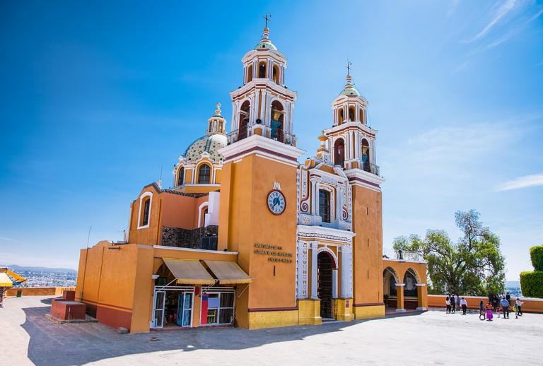 Santuario de los remedios, Cholula, Puebla, Mexico (Orange colonial catholic church with two bell towers built atop Tlachihualtepetl mayan pyramid)