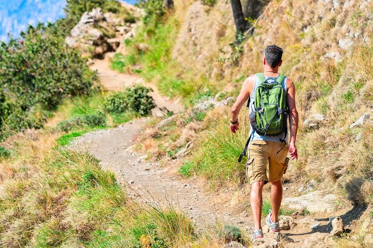 Man with backpack at Path of Gods, Amalfi coast, Italy
