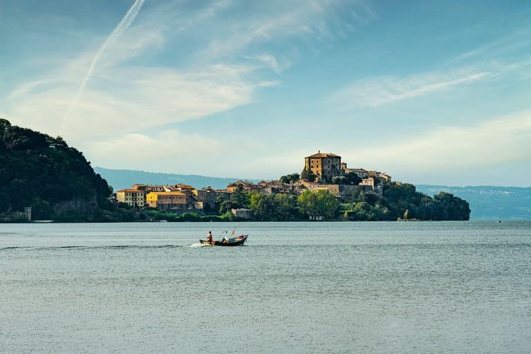 The Rocca Farnese in Capodimonte dominates the promontory that extends over Lake Bolsena. Capodimonte, Viterbo, Lazio, Italy