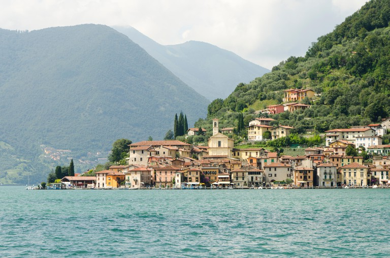 Lake Iseo Italy. Lago d'Iseo or Sebino with the village Peschiera Maraglio behind. Lombardy region. Northern Italy.
