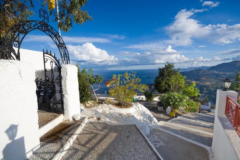 Entrance portal to Tsampika Monastery - Orthodox monastery located on top of craggy rock on eastern coast of Rhodes Island, Greece