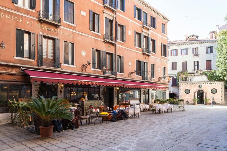 Taverna La Fenice, Campiello la Fenice, San Marco, Venice, Veneto, Italy with its comfortable outdoor lounge area with armchairs