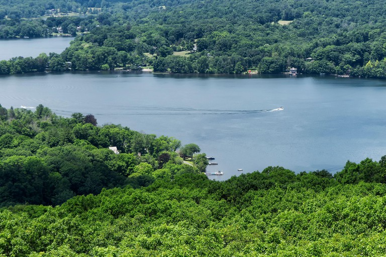 A view of Lake Waramaug from atop the pinnacle on the marcicpstas preserve in New Preston Connecticut in the summertime.