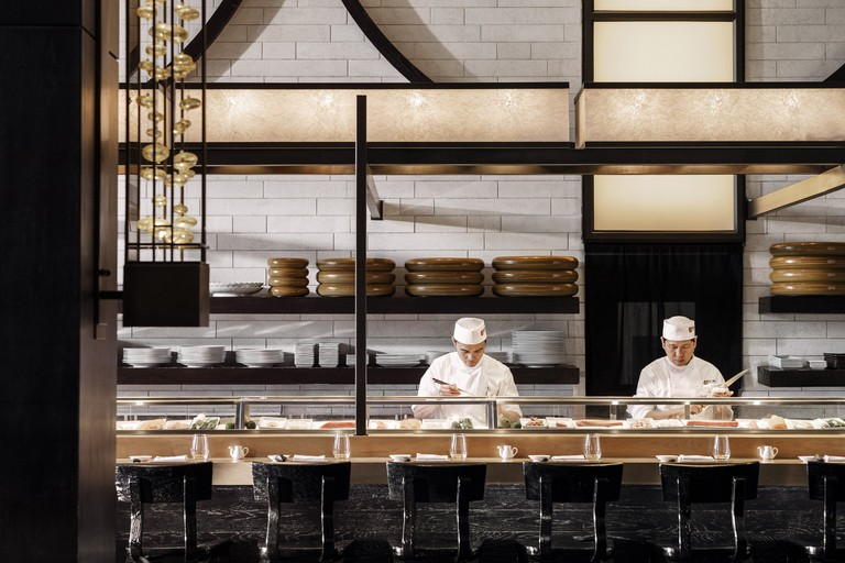 Chefs cook in an open kitchen at One&Only in Cape Town