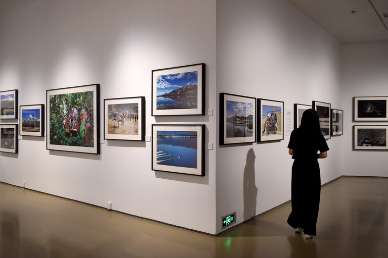 Beijing, China. 4th July, 2018. A visitor views photographic works at a photo exhibition in Today Art Museum in Beijing, capital of China, July 4, 2018. The exhibition, organized by the tourism authorities in Ali Prefecture of southwest China's Tibet Auto