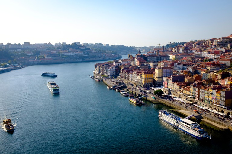 Elevated view of Porto, Portugal and the River Duoro with passenger ships, a popular tourists destination