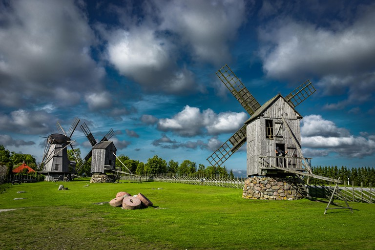 View towards Collection of old windmills at Angla Windmill Hill on a sunny day with blue sky and clouds in Saaremaa. Photo taken in Estonia