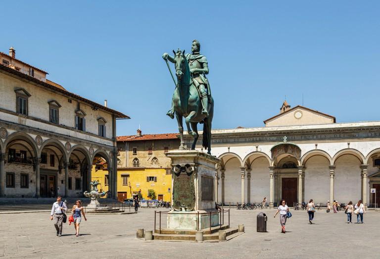 Florence, Florence Province, Tuscany, Italy.  Piazza della Santissima Annunziata.  Statue of Ferdinando I de' Medici, Grand Duke of Tuscany, 1549 ? 16
