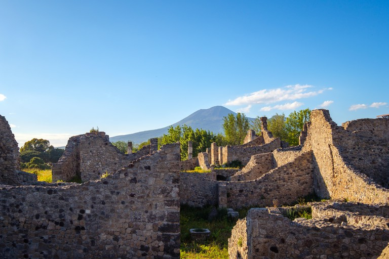 Landscape view of ancient Pompeii town with Vesuvius volcano background, Italy