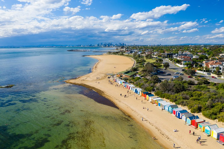Aerial view of Brighton Bathing Boxes and Melbourne CBD