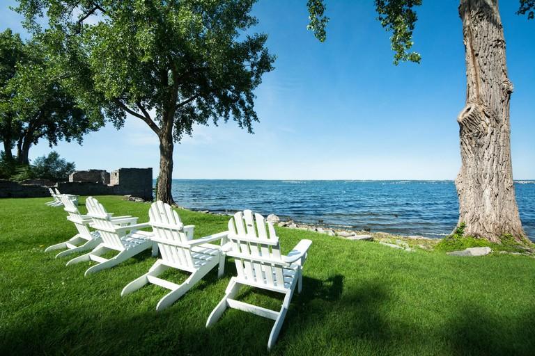 Adirondack chairs for relaxing along the shoreline of Cayuga Lake, Aurora, New York, USA