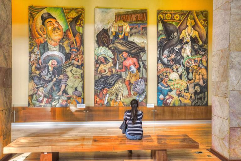 Woman Admiring the Mural Paintings of Diego Rivera, Palacio de Bellas Artes, Mexico City, Mexico