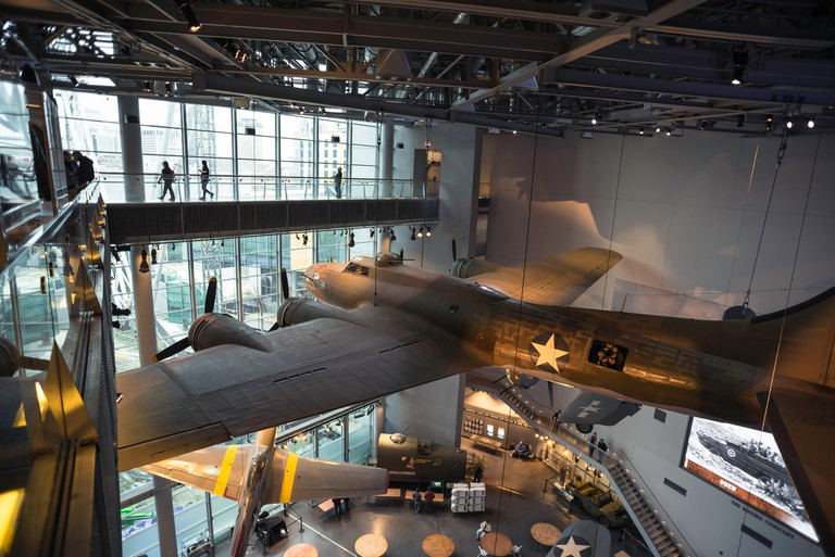 View of WWII warplanes displayed inside the National World War Two Museum in the Warehouse District of New Orleans, Louisiana, USA.