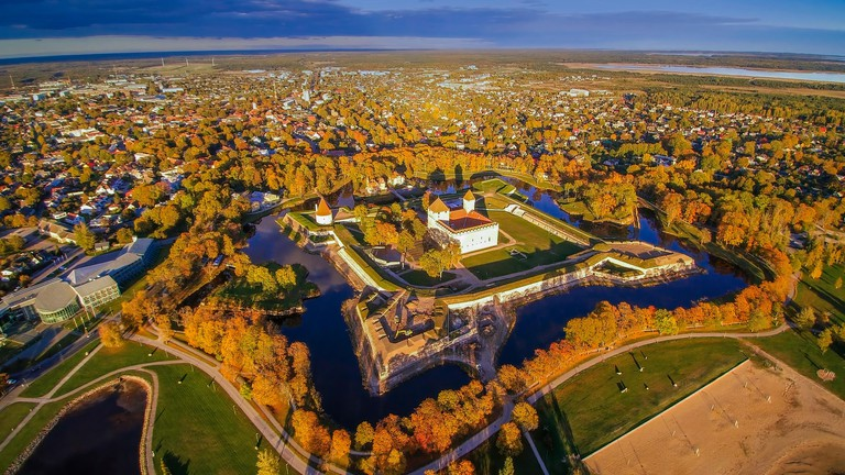 The green yet progressive city of Kuressaare. Seen the trees surrounding the houses and roads and the castle on the middle of the city