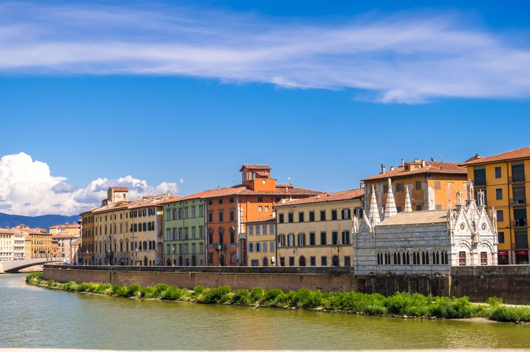 Pisa, Italy - August 14, 2019: Gothic church Santa Maria della Spina on the embankment of the Arno River in Pisa, region of Tuscany, Italy