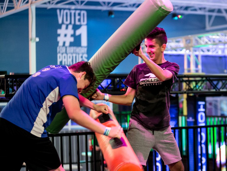 Florida, USA. 1st Apr, 2019. A preview event for first responders, their families, and friends Friday at the new Urban Air Adventure Park in Wellington. The indoor park features virtual reality, a sky rider coaster, a ropes course, climbing walls, a battl
