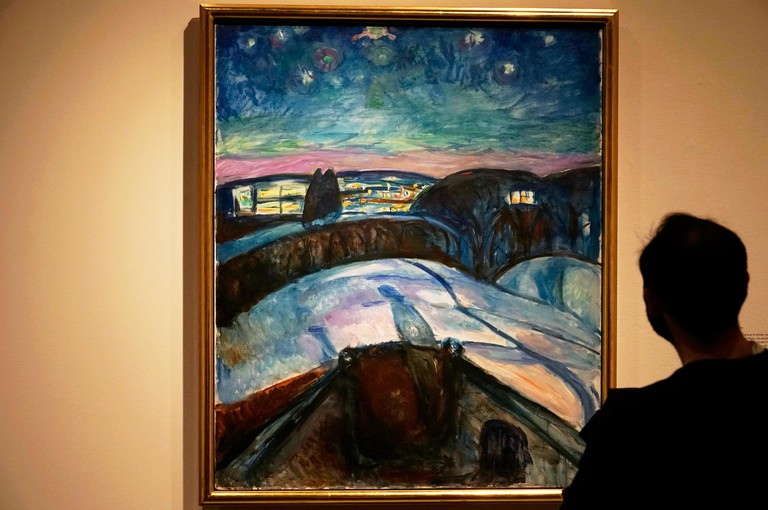 T7A5P4 A visitor admiring the Starry Night (1922-24) by Edvard Munch.Munch Museum.Oslo.Norway