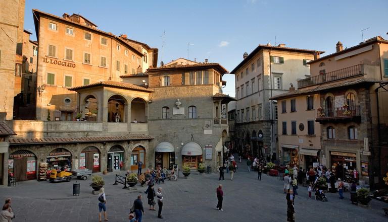 Piazza della Repubblica, Cortona, Arezzo, Italy from the steps of the Palazzo Communale, showing the loggia in Piazza Peschiera to the left