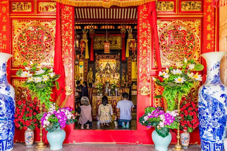 Praying at Jui Tui shrine in Phuket Old Town, Phuket - T8092Y