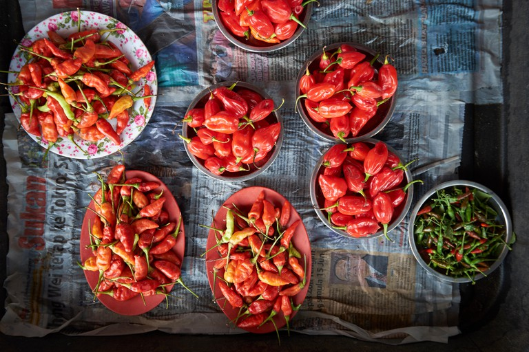 Red and green chili peppers for sale at the Tamu Muhibbah central food market in Miri, Borneo, Malaysia.