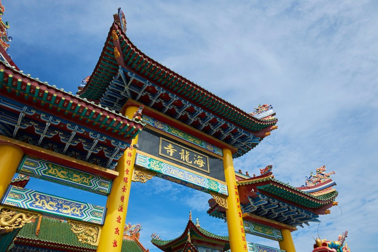 Front gate to the new, colorful Hai Long Si Chinese temple in Miri, Borneo, Malaysia