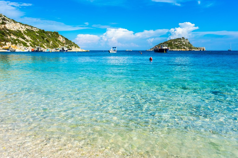 Greece, Zakynthos, Perfect sand beach and turquoise water at agios nikolaos harbor