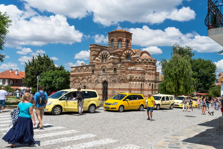 Nessebar, Bulgaria July 15, 2019. A crowd of people walking around the ancient  city of Nessebar in Bulgaria.Orthodox church of Christ Pantocrator