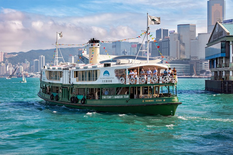 Star Ferry Harbour Tour boat with tourists on board in Victoria Harbour. Hong Kong, China.