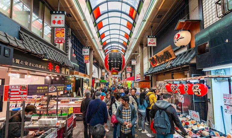 Visitors at Kuromon Ichiba Market, Osaka, Japan. Image shot 2019. Exact date unknown.