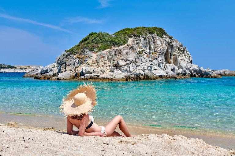 Woman in bikini on beach. Image shot 04/2019. Exact date unknown.