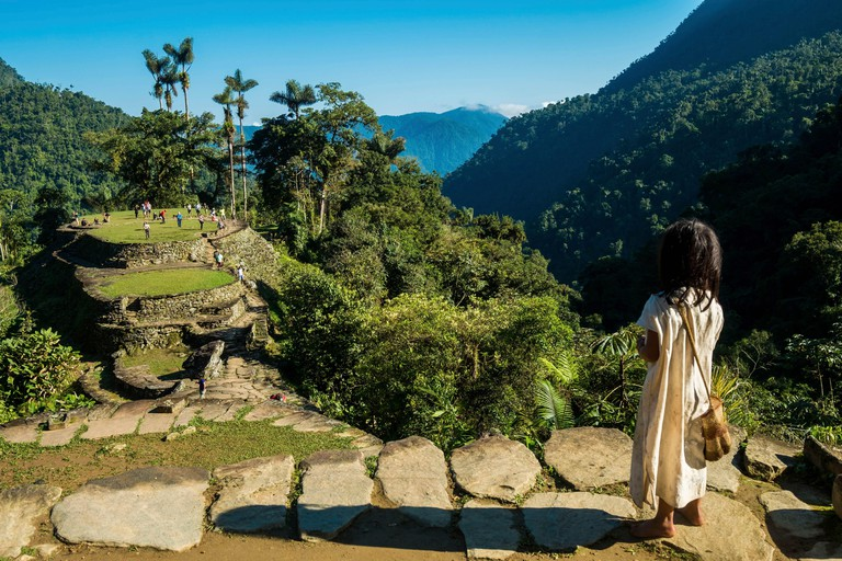 Colombia, Sierra Nevada de Santa Marta, Tayrona Park, trek of the Lost City, registered World Heritage by UNESCO, kogi child contemplating the first groupes of tourists getting to the site
